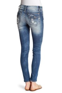 jeans with extreme fading on the seat and flap back pockets