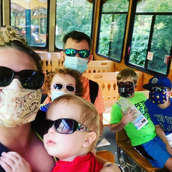 Family of six inside a wooden trolley in Niagara Falls Scenic Trolley