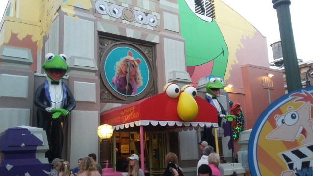 Entrance to muppet 3D movie: red monster with yellow nose and green Kermit to the left
