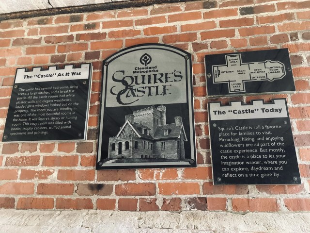 """Plaques with a map of the castle, """"the castle today"""", """"The castle as it was"""" and a Squire's Castle plaque."""