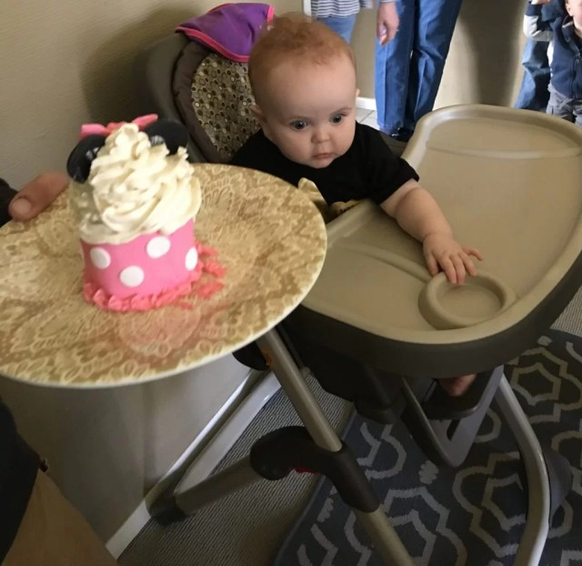 minnie mouse smash cake and baby in high chair