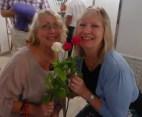 happy ladies with roses