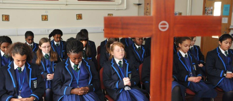 Students during prayer in the school chapel