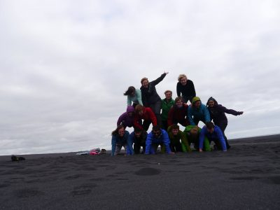 Unsuccessful human pyramid attempt on the wide black sands of an infinite beach, A Waldron