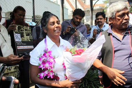 <p>Tamil rights activist Balendran Jeyakumari (center) stands with supporters after being released on bail yesterday (Credit: ucanews.com)</p>