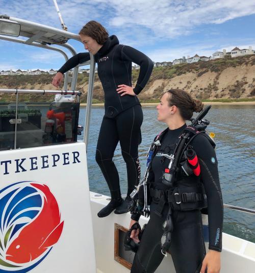 Two women scientists aboard research vessel on diving field work