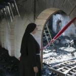 راهبة تتفقد مكان الحريق