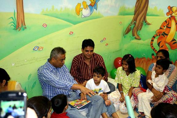 Rajdeep Sardesa along with little Arjunuday narrating the Foolish Lion and the Clever Rabbit Tale