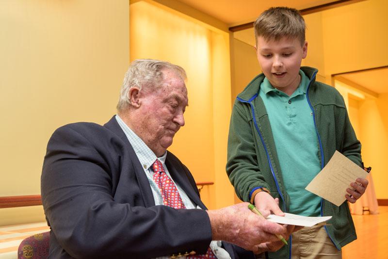 paleoanthropologist Richard Leakey signs autograph