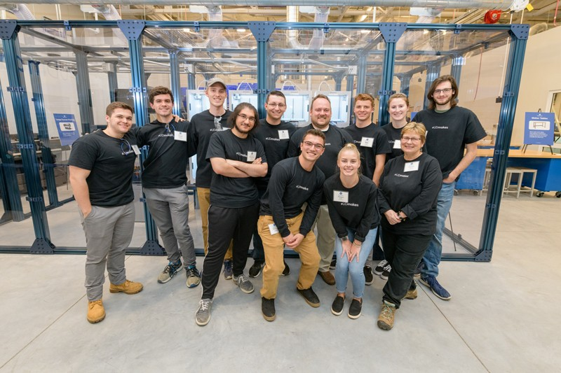 Operations staff and student assistants pose for a photo in the MakerGym. Front row, from left: Metehan Cebeci, Michael Slemko, Megan Wolfe and Donna Svinis (technician). Back row, from left: Sean Morris, Ethan Bishop (technician), Alex Newkirk, Justin DiGiovanni, Brooks Twilley (operations manager), Matt Walton, Mallory Smith and Ethan Kempista.