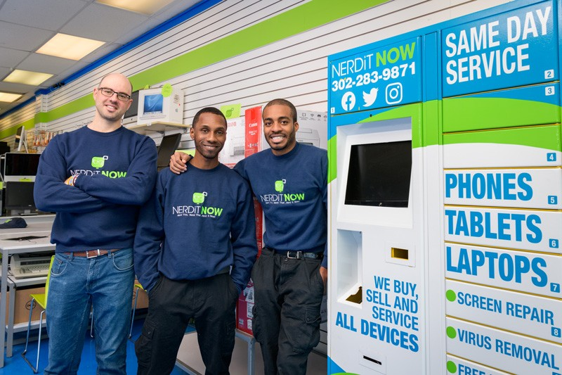 Left to right, Jake Voorhees, Jonathan Hoxter and Markevis Gideon stand next to their kiosk in their store in Newport, Delaware. They hope to eventually have 250 kiosks.
