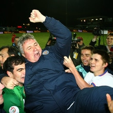 Russia coach Guus Hiddink celebrates his side's qualification