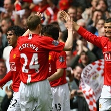 Cristiano Ronaldo (right) celebrates his opening goal against Manchester City
