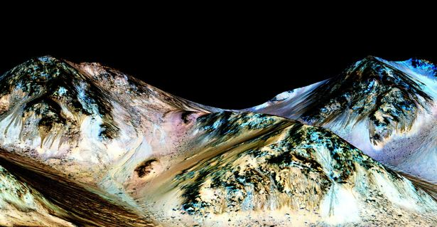 NASA scientists believe that flowing liquid water is almost certainly responsible for mysterious features on Mars that change with the seasons