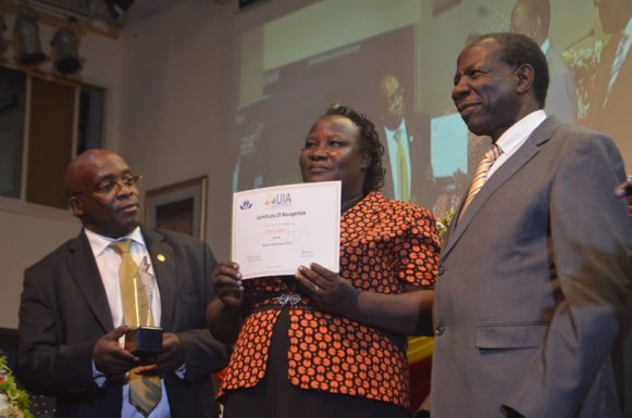 Ms. Okot Folrence (C) of Yellow Star Poduce won Woman Enterprenuer of the Year Award