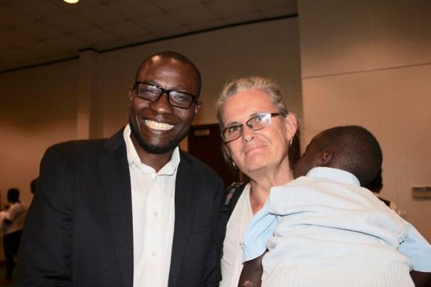 Peter Sewakiryanga, left, executive director of the KCM organization