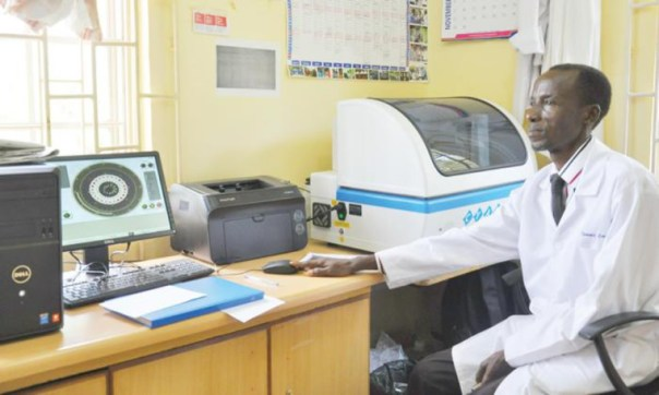 Zac Tamale, senior lab technician at Allan Galpin Health Centre, operates the new machine.
