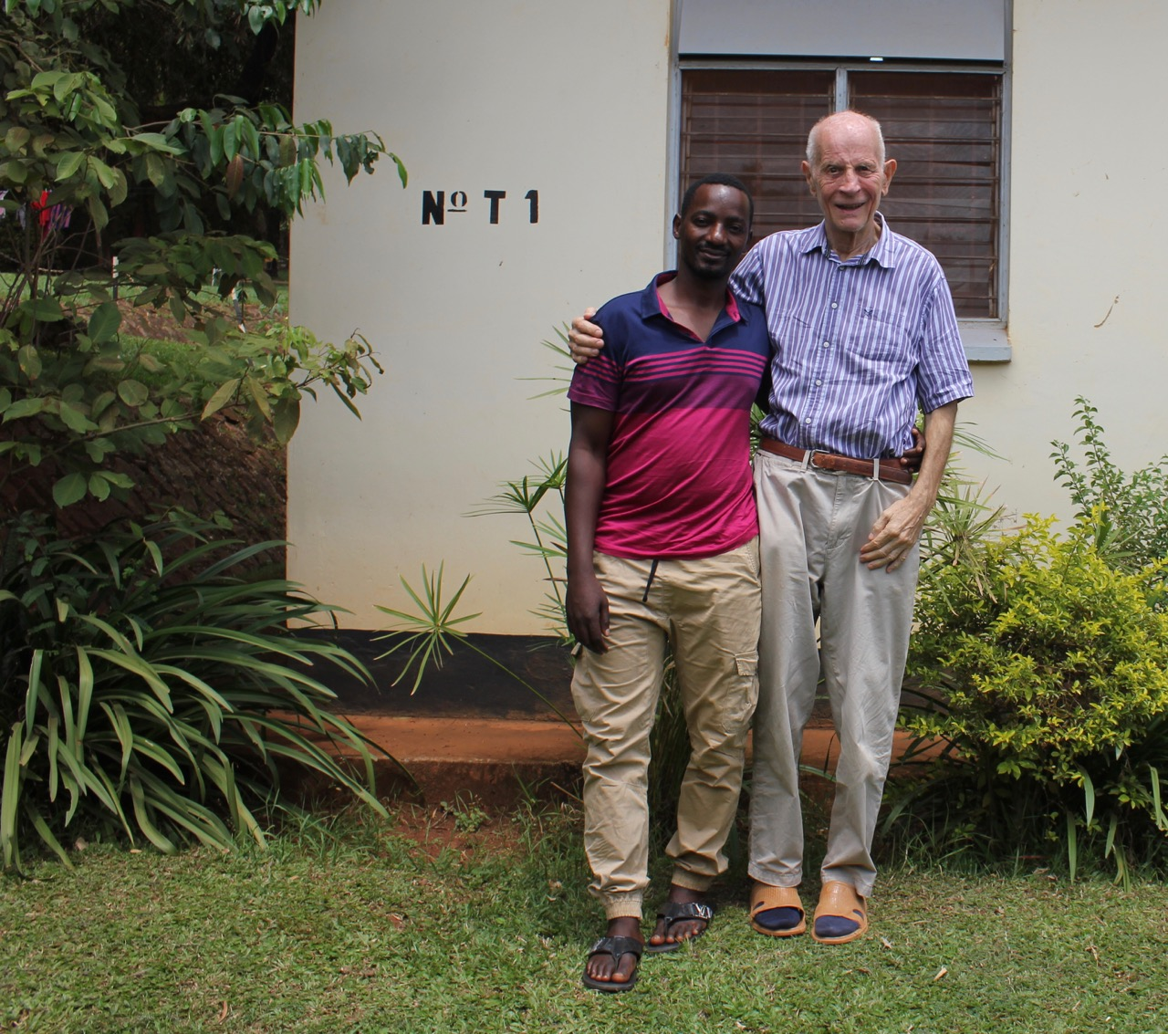 "John Smith with a former student, Alex Kamoga, who calls the math instructor ""a great pillar in my life…he paid all my school fees."" (UCU Partners photo)"