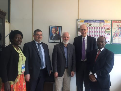 Dr. Miriam Mutabazi (left), Doug Fountain (second from left), and their consultation team, meeting with Dr. Henry Mwebesa (right) of Ministry of Health, Uganda. (UCUPartners Photo)