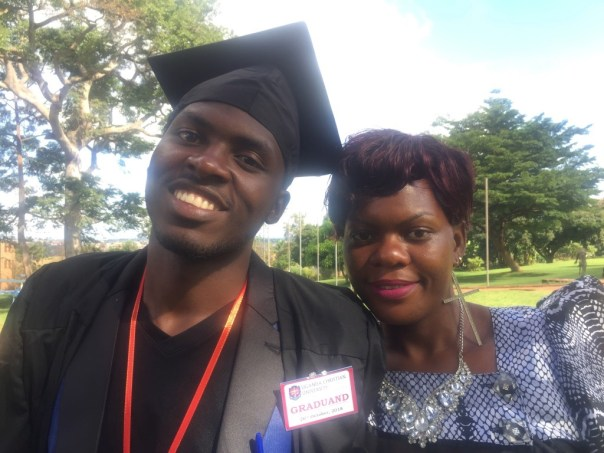 Matende Wilson with his mother on his graduation day in October 2018. (UCU Partners Photo)