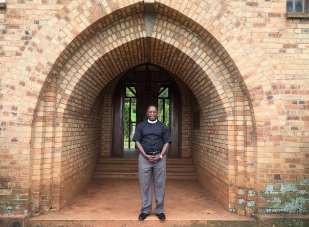 The Rev. Eng. Paul Wasswa Ssembiro outside Principal's Hall