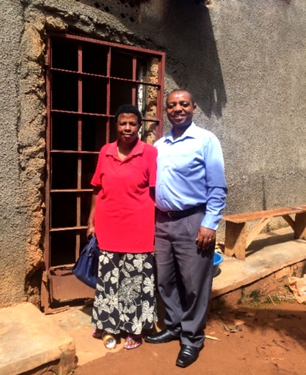 The Rev. Emmanuel Mukeshimana, right, with a widow he has helped.