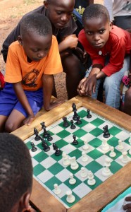 Children learning about life and chess at SOM Chess Academy in Katwe (UCU Partners Photo)