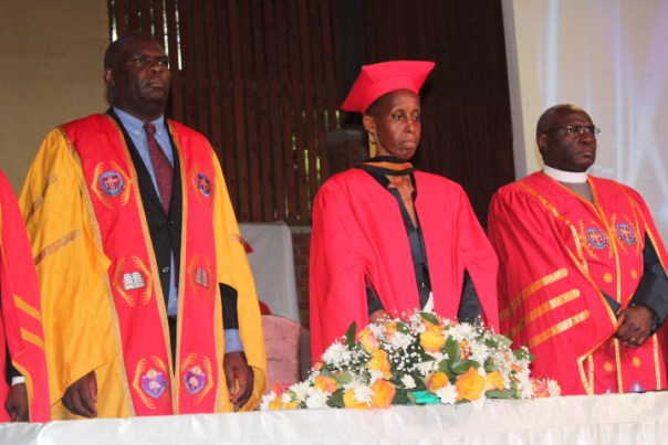 Prof. Monica Chibita with her husband, Justice Mike Chibita (left) and the Uganda Christian University Vice Chancellor, Rev. Canon Dr. John Senyonyi at the inaugural lecture