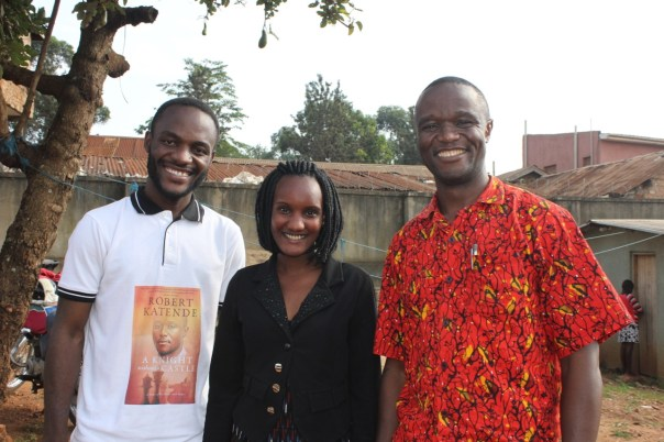 "UCU students Ivan Mutesasira and Mildred Nampala pose with chess and ""overcomer"" coach Robert Katende. All are from Katwe. (UCU Partners Photo)"