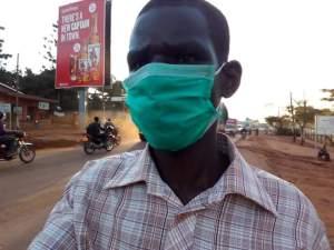 Olum Douglas in his mask, walking in Mukono Town during the lockdown