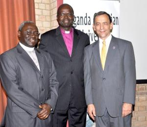 Former UCU Vice Chancellor, Dr. Stephen Noll, right, and John Senyonyi, left, with Henry Luke Orombi, former Archbishop of the Church of Uganda