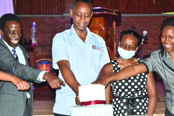 UCU Vice Chancellor Assoc. Prof. Aaron Mushegyezi (second from left) helps cut cake at the birding course graduation. Also pictured are Mrs. Mary Kajumba of the Private Sector Foundation, Assoc. Dean of the School of Business Mrs. Elsie Nsiyona and Dr. Martin Lwanga, the outgoing Dean of the School of Business.