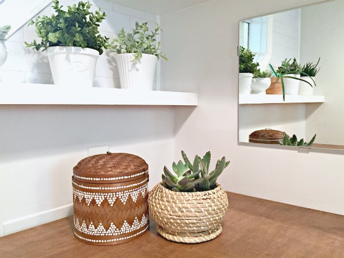 mix of real and fake plants in laundry room
