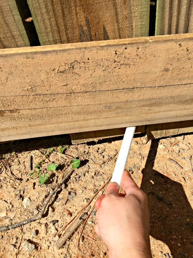 use carpenters pencil to mark pickets along gate