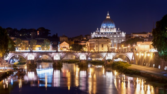 St. Peter's Cupola as seen from Ponte Umberto I in Rome at night
