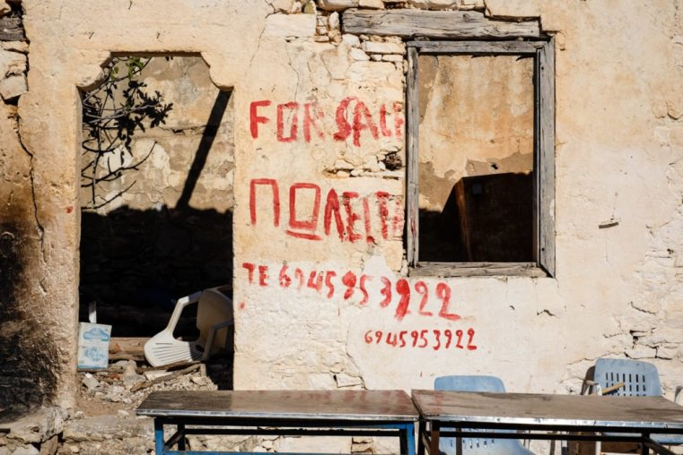 """Abandoned house with """"For Sale"""" graffiti"""