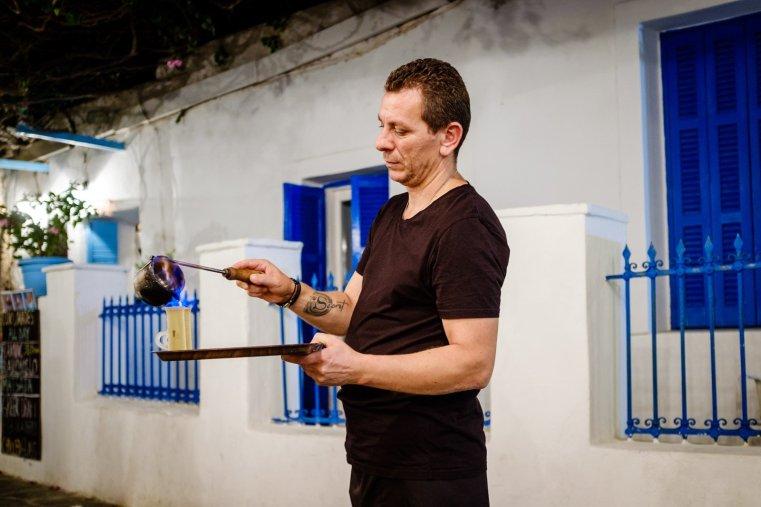 Nikos serving Rakomelo, Folegandros Chora, Greece
