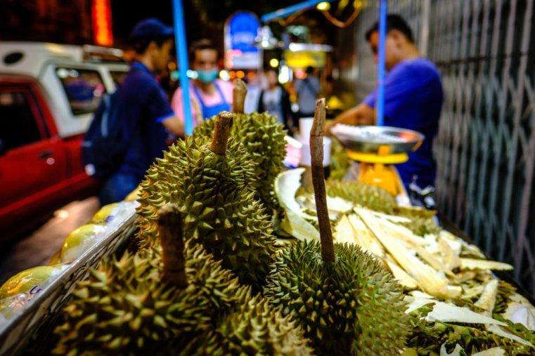 Cart selling durians on the street. Yaowarat Road, Chinatown, Bangkok