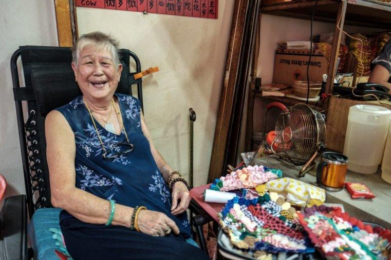 Smiling lady, Singapore