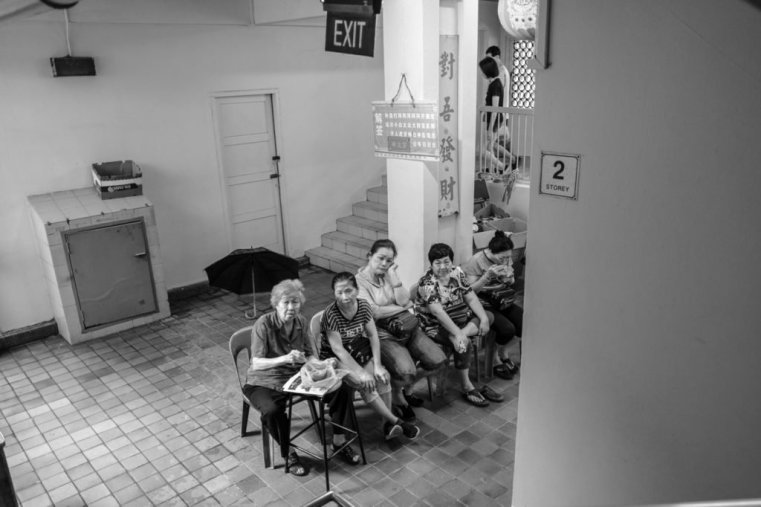 Lunch time in a public housing complex, Singapore