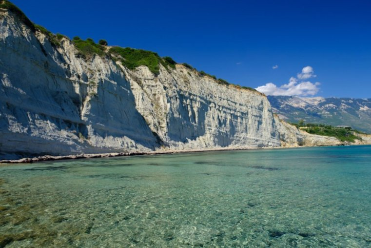 The white cliff and pristine waters at Spartia