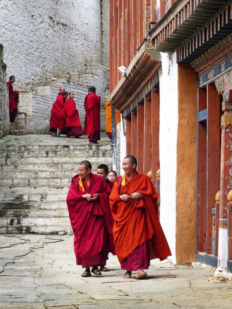 Monks in central courtyard, Trongsa Dzong, central Bhutan