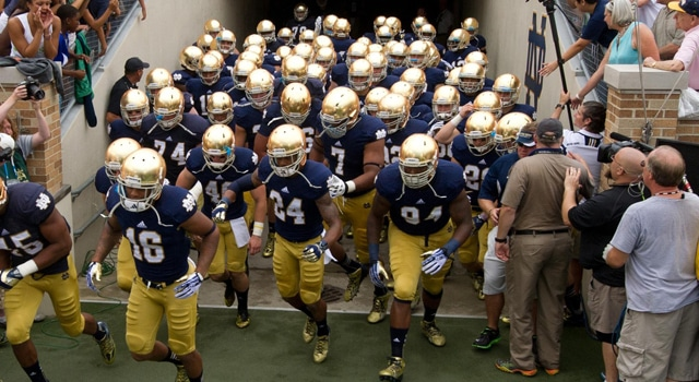 Notre Dame Fighting Irish head coach Brian Kelly leads his players onto the field before the game against the Temple Owls at Notre Dame Stadium. Notre Dame won 28-6. Mandatory Credit: Matt Cashore-USA TODAY Sports
