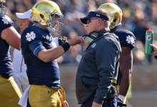 Notre Dame QB Ian Book and head coach Brian Kelly