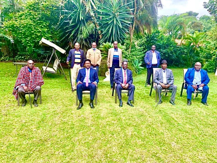 ODM Party Leader Raila Odinga with Narok Senator Ledama Ole Kina and a section of Maasai leaders at his Karen home this morning where his forgiveness was delivered