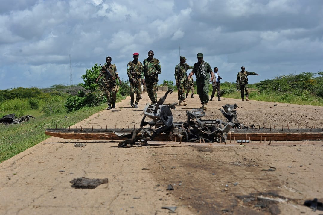 Debris is seen at a check point as Somali soldiers patrol near Sanguuni military base, where an American special operations soldier was killed by a mortar attack on June 8, about 450 km south of Mogadishu, Somalia, on June 13, 2018