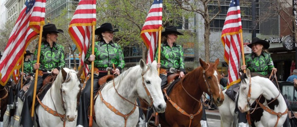 U.S. flag displayed by horse-mounted marchers in a San Francisco St. Patrick's Day Parade (perhaps 2014); image from United Irish Societies of San Francisco (UISSF).