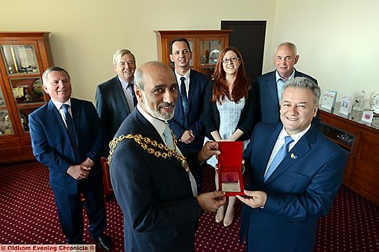 The Mayor of Oldham Cllr. Fida Hussain (left) meets the Mayor of the Municipality of Ferijaz, Republic of Kosovo, Muharrem Svarqa. In the background are left to right, Faik Graica, John Battye (the Oldham Mayor in 1999 who greeted the first group of Kosovan refugees), Burim Karameta, Ailsa Plain (Foreign and Commonwealth Office), Osman Caka (one the first refugees).