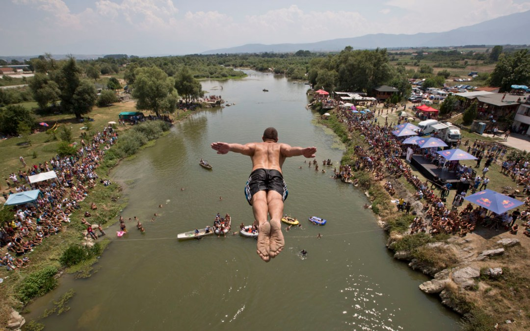 AP Photo: High-diving from a bridge in Kosovo