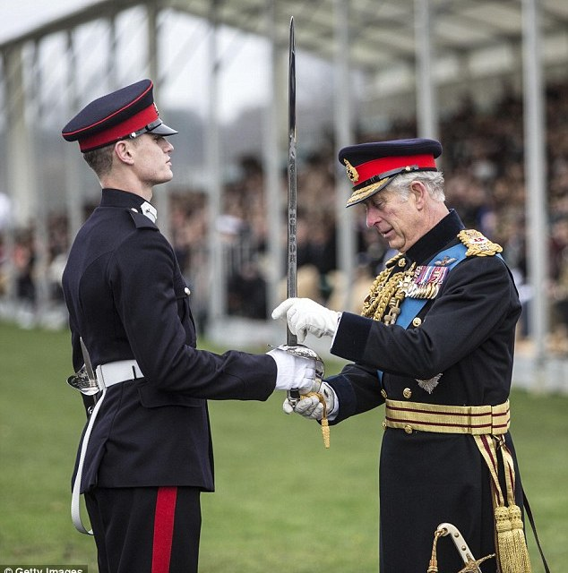 Officer cadet Ismail Hoxha from Kosovo receives the overseas sword from Prince Charles